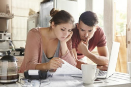 Young Couple Looking at Their Credit